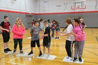 middle school students work together to get across imaginary lava game