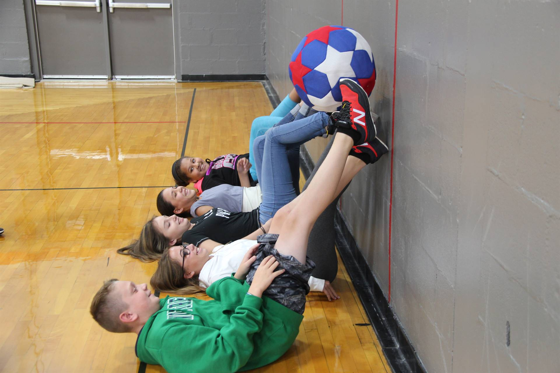 middle school students work together to move ball as part of team building exercise