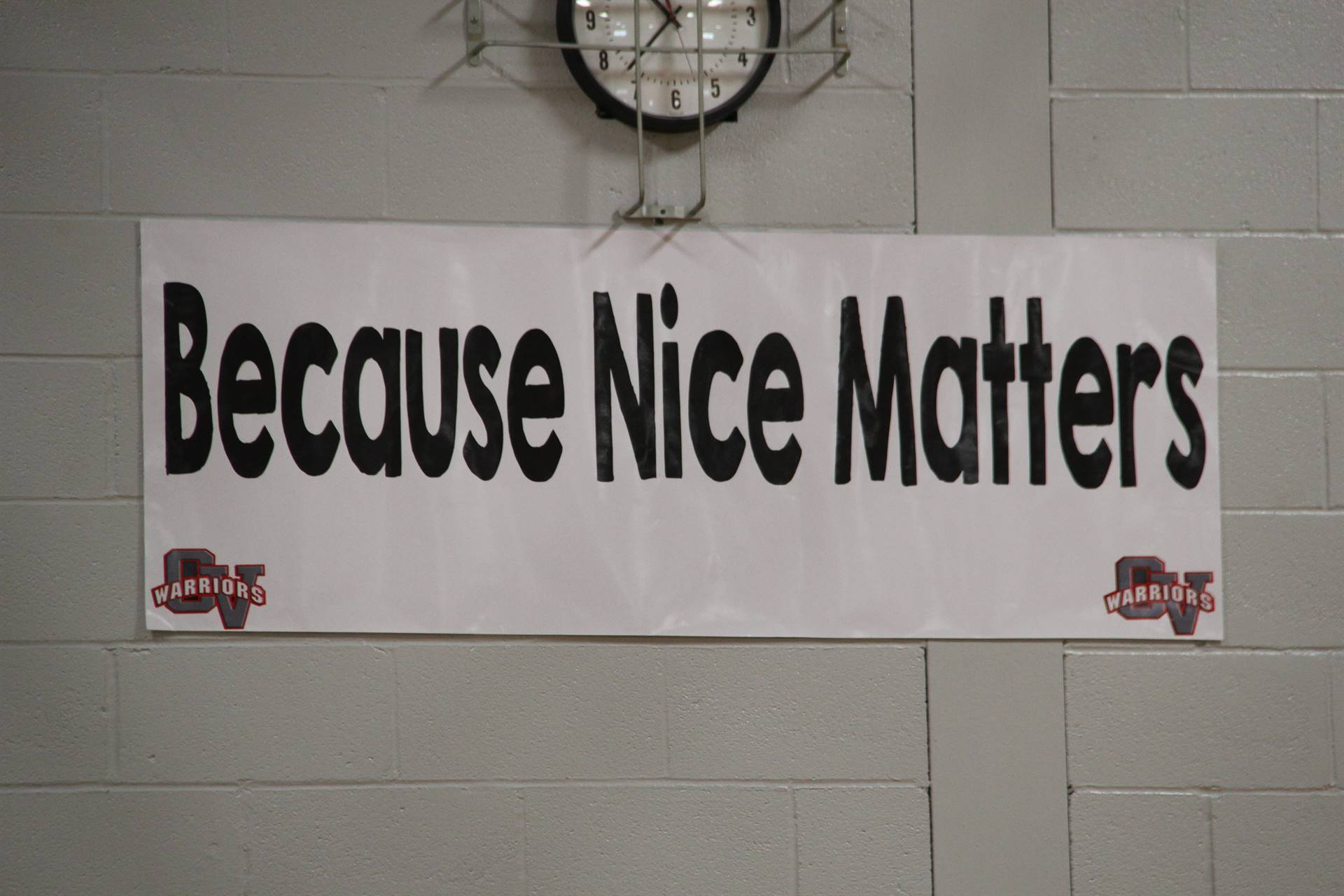 sign that reads because nice matters in middle school gym