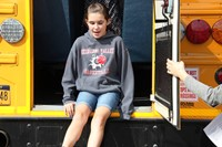 student exits through back of bus during bus drill