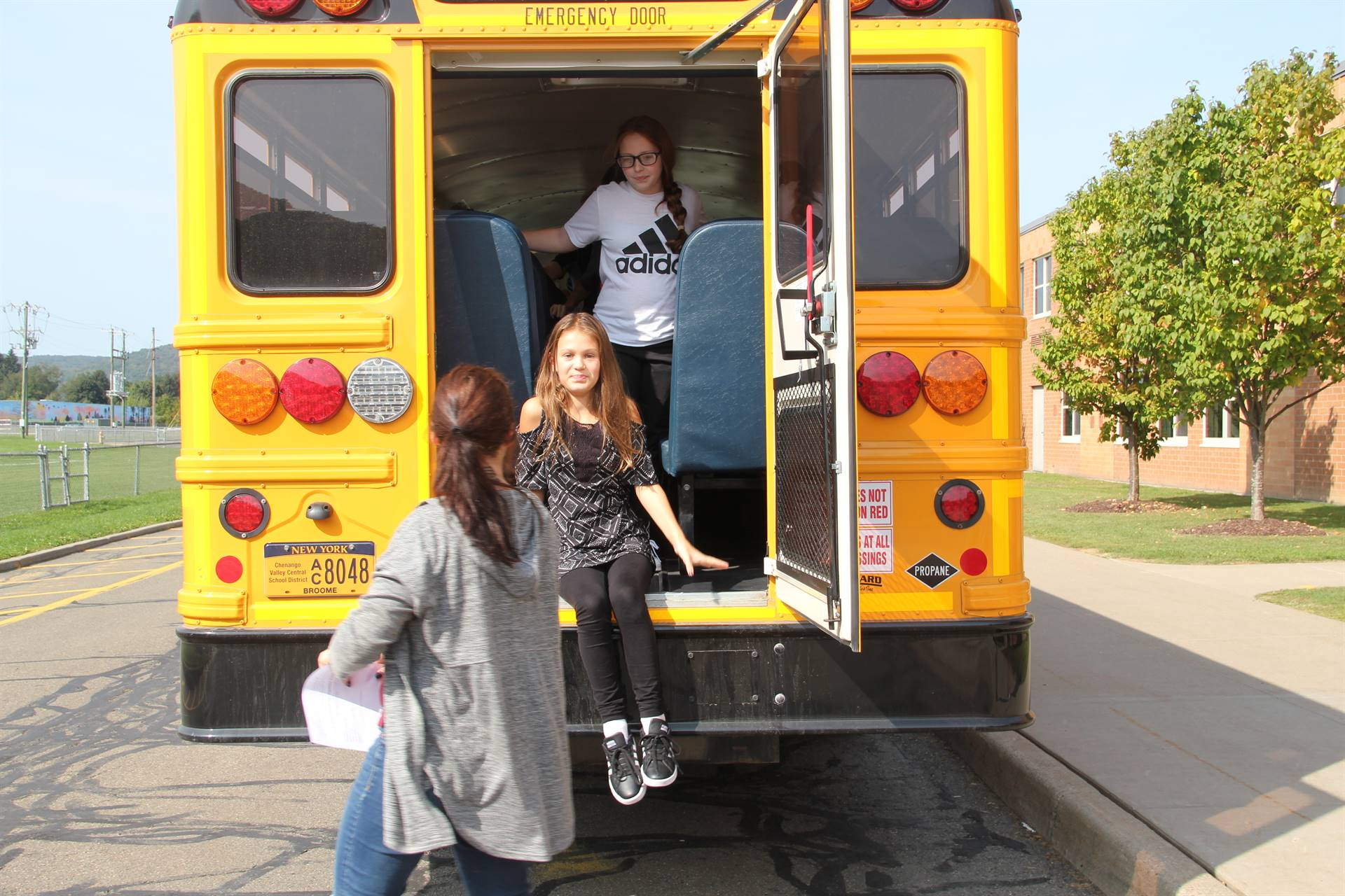 students exit back of bus for bus drill