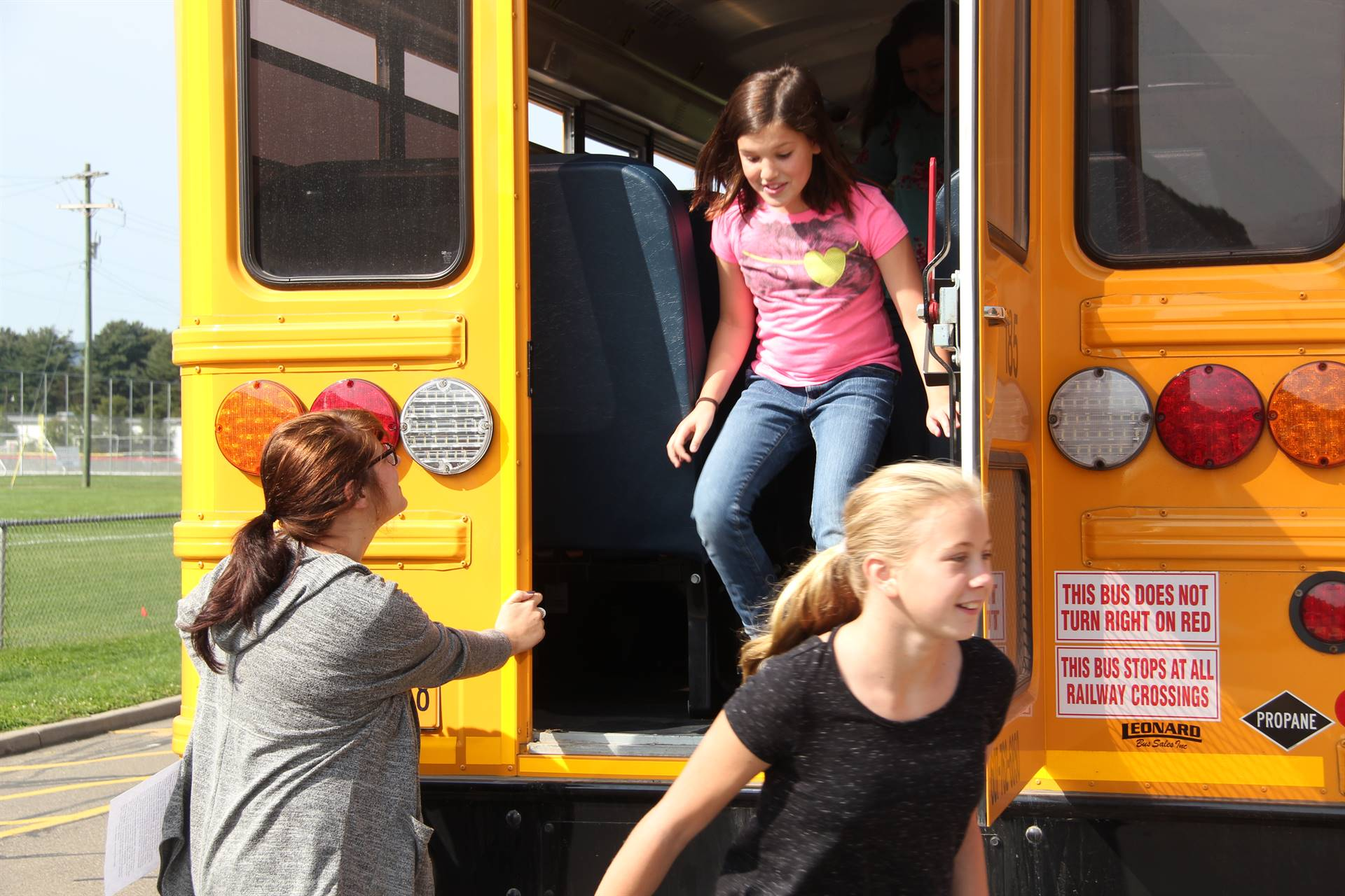 students exit from back of the bus for bus drill