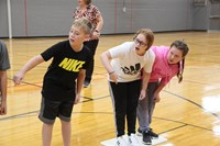 students play a challenge of lava game for team building exercise