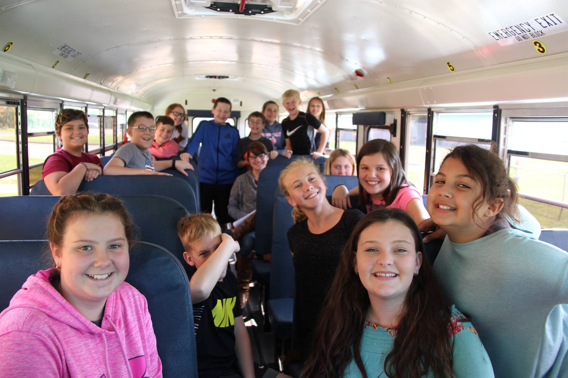 students smile happy to do bus drill