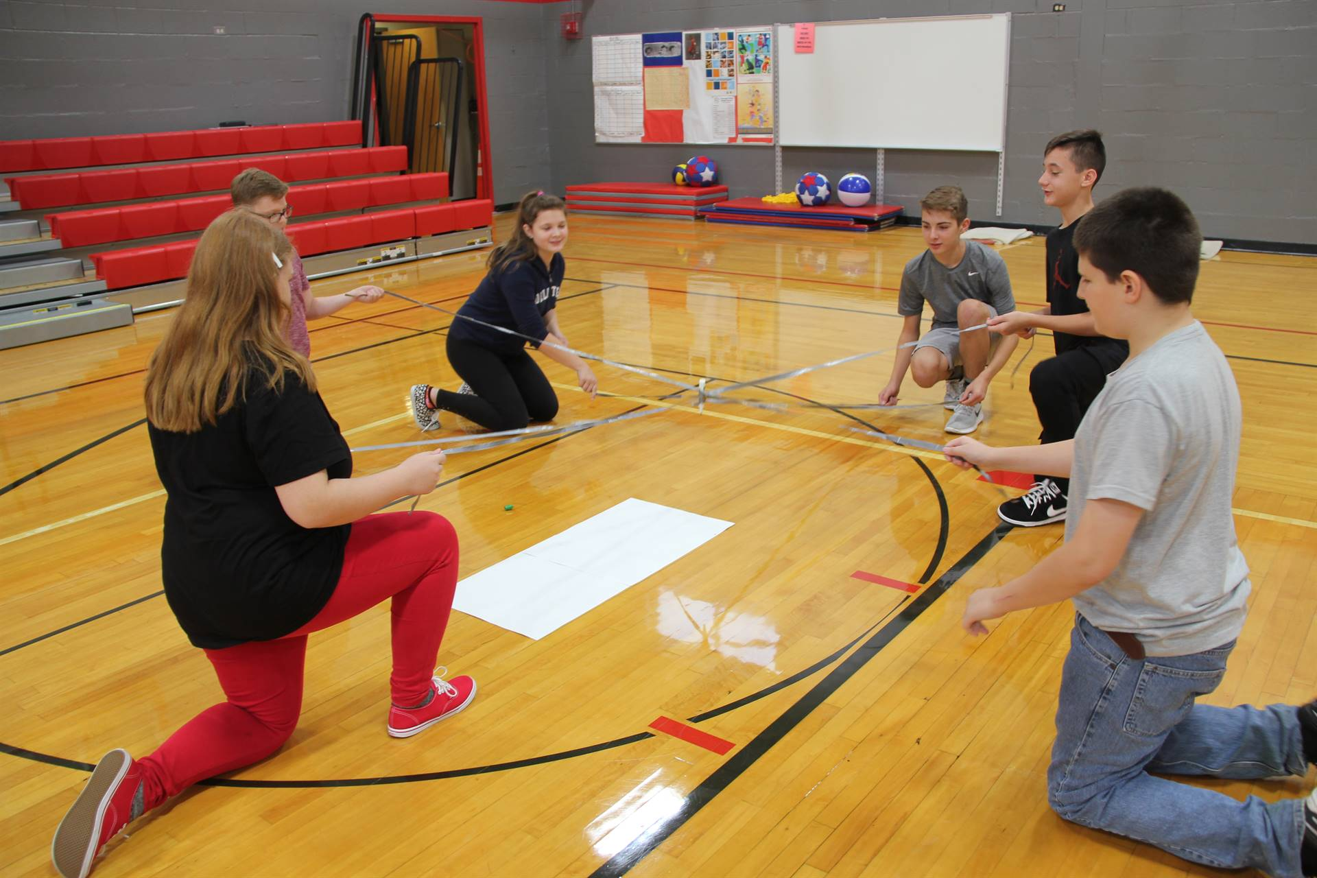 middle school students taking part in writing challenge
