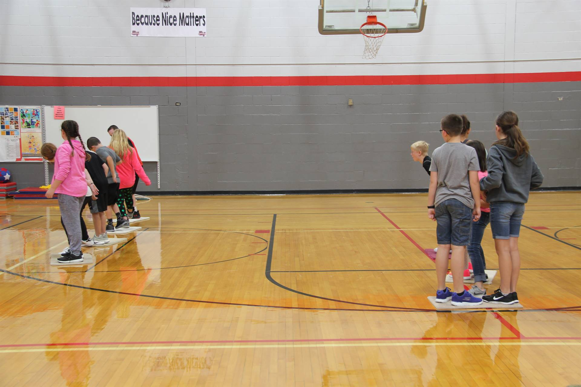 wide shot of students playing team building lava challenge game