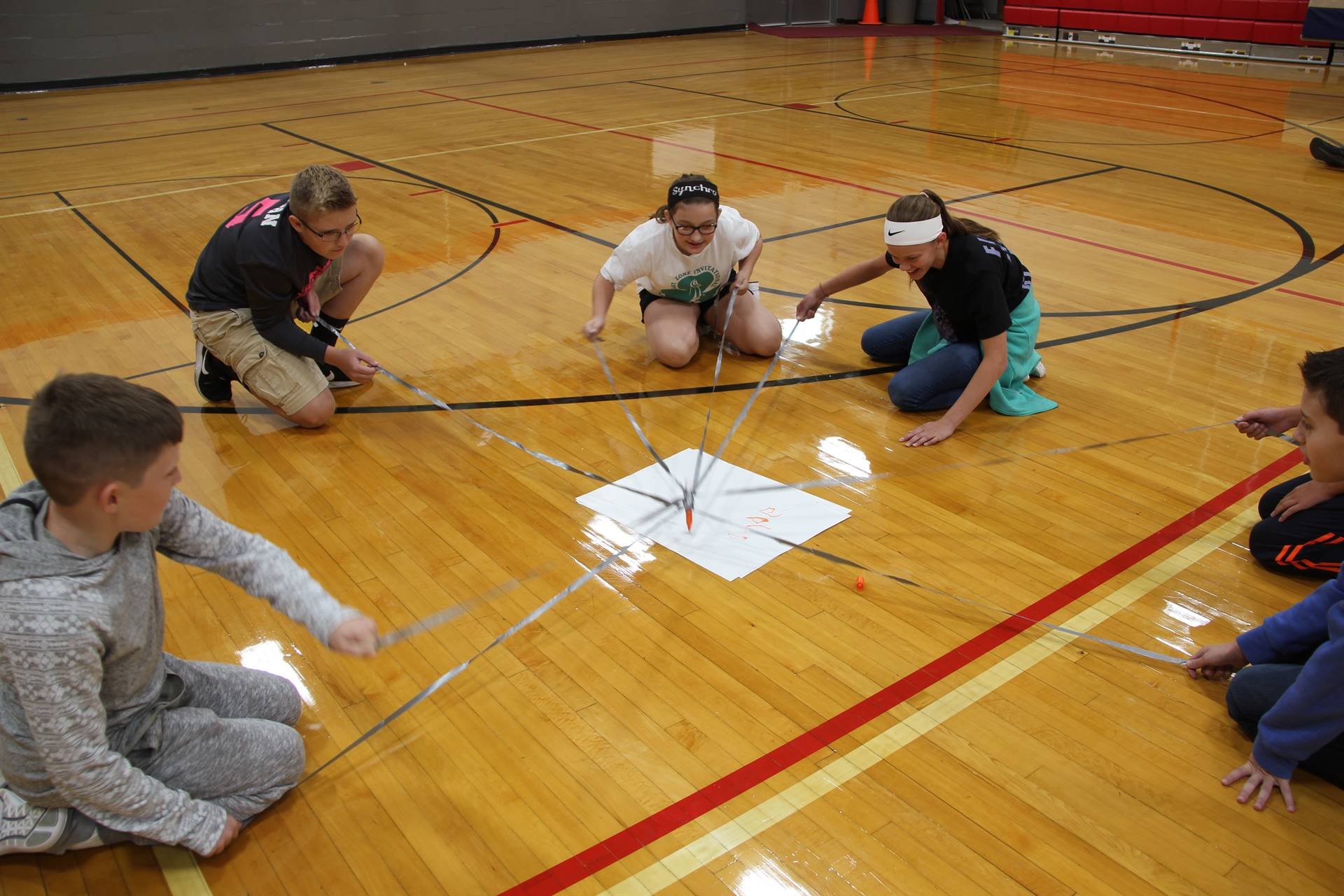 students work to write positive message working together in writing challenge game