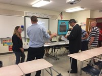 parents talk with teacher at middle school open house