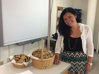 teacher stands next to cookies that students made for middle school open house