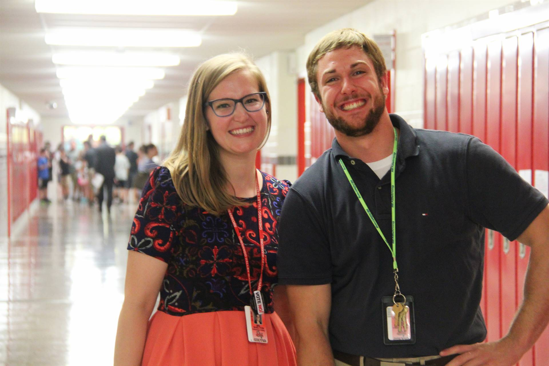 teachers smile in the hallway at middle school open house