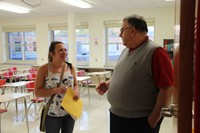 teacher and parent talk at middle school open house