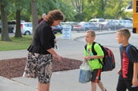 principal mary beth hammond speaks with two students about to enter first day of school at chenango