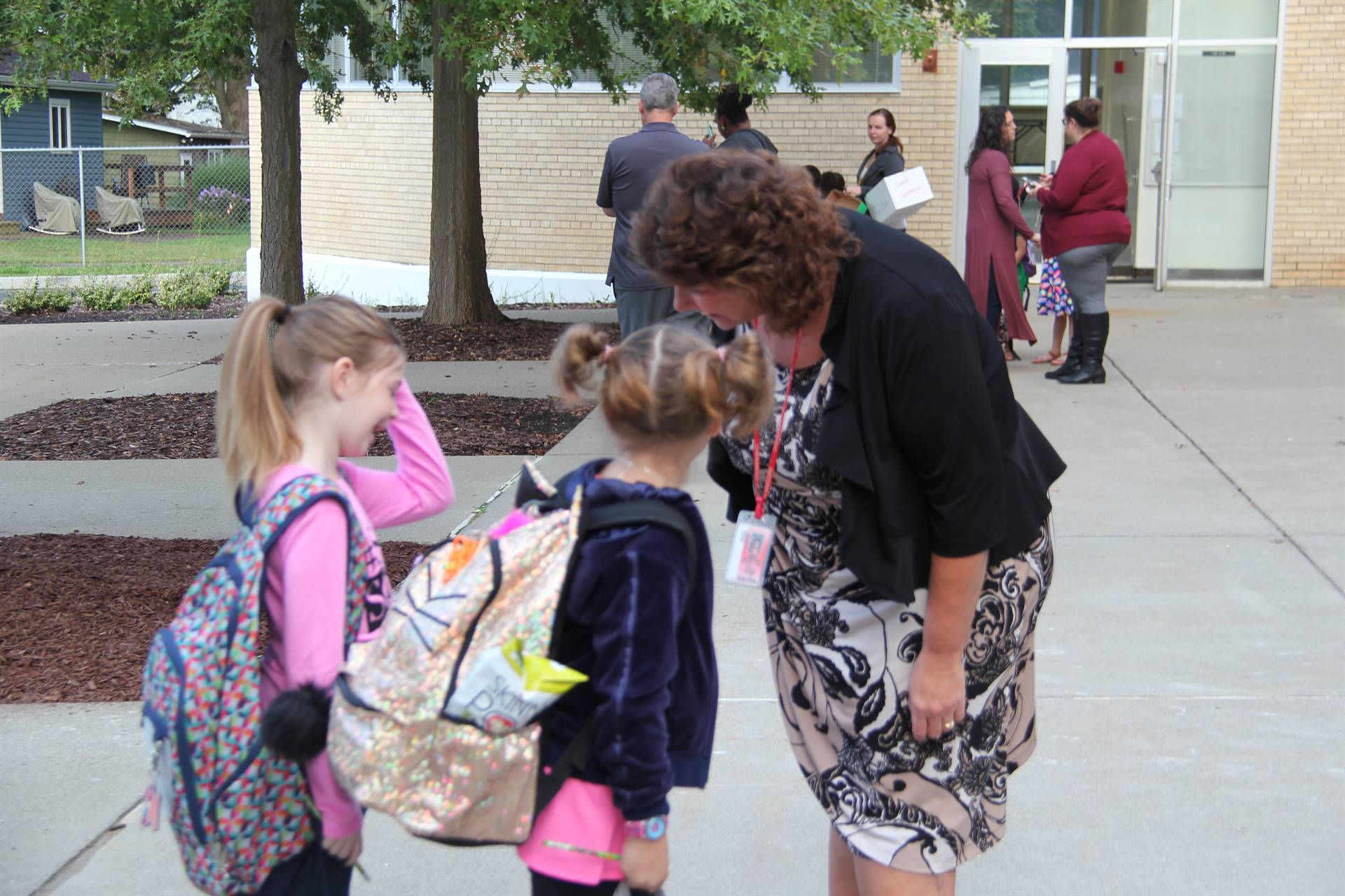 principal mary beth hammond talks with two students outside chenango bridge elementary school on fir