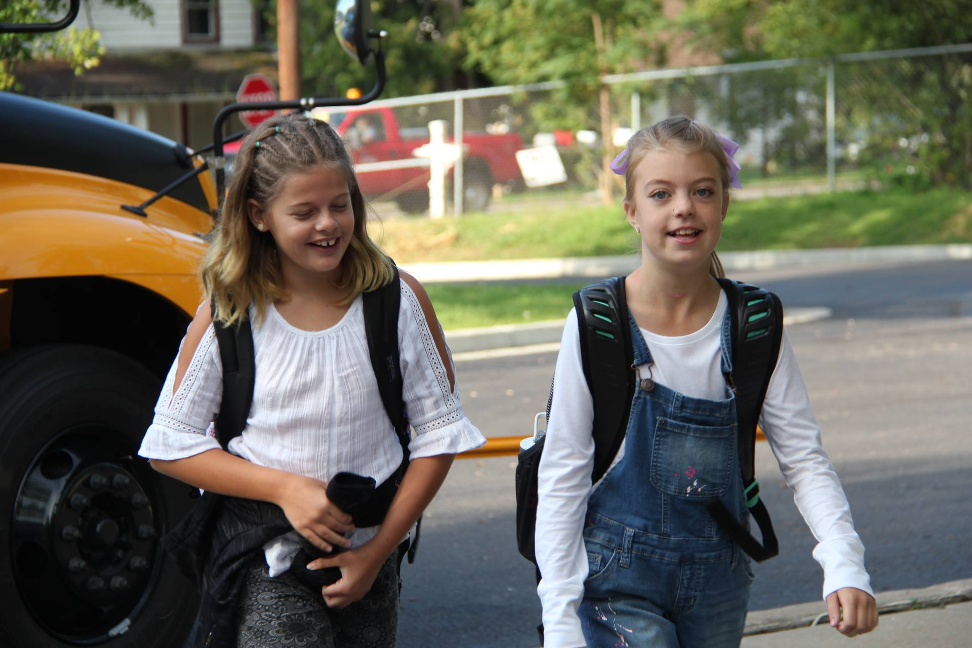 girls walk toward chenango bridge elementary school on first day
