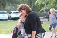 student gives principal mary beth hammond a hug on first day of school