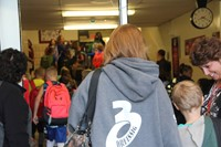 students line up in hallway to enter chenango bridge elementary school