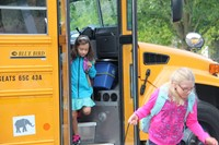 students getting off the bus for the first day of school at chenango bridge elementary