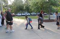 wide shot of students walking towards chenango bridge elementary school on first day