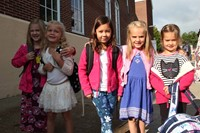 students smile outside of port dickinson elementary school on first day