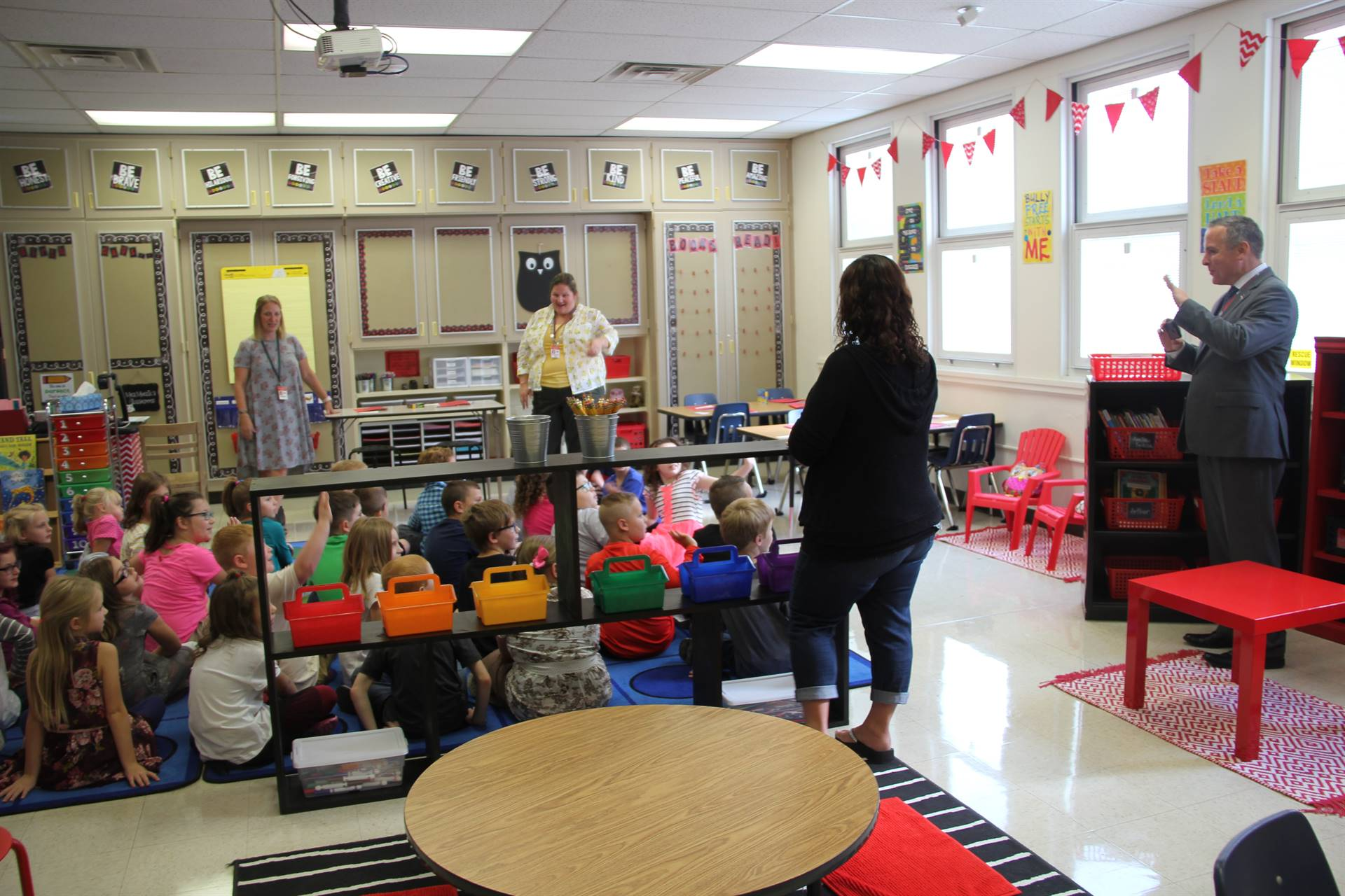 second grade classroom students speak with superintendent gill