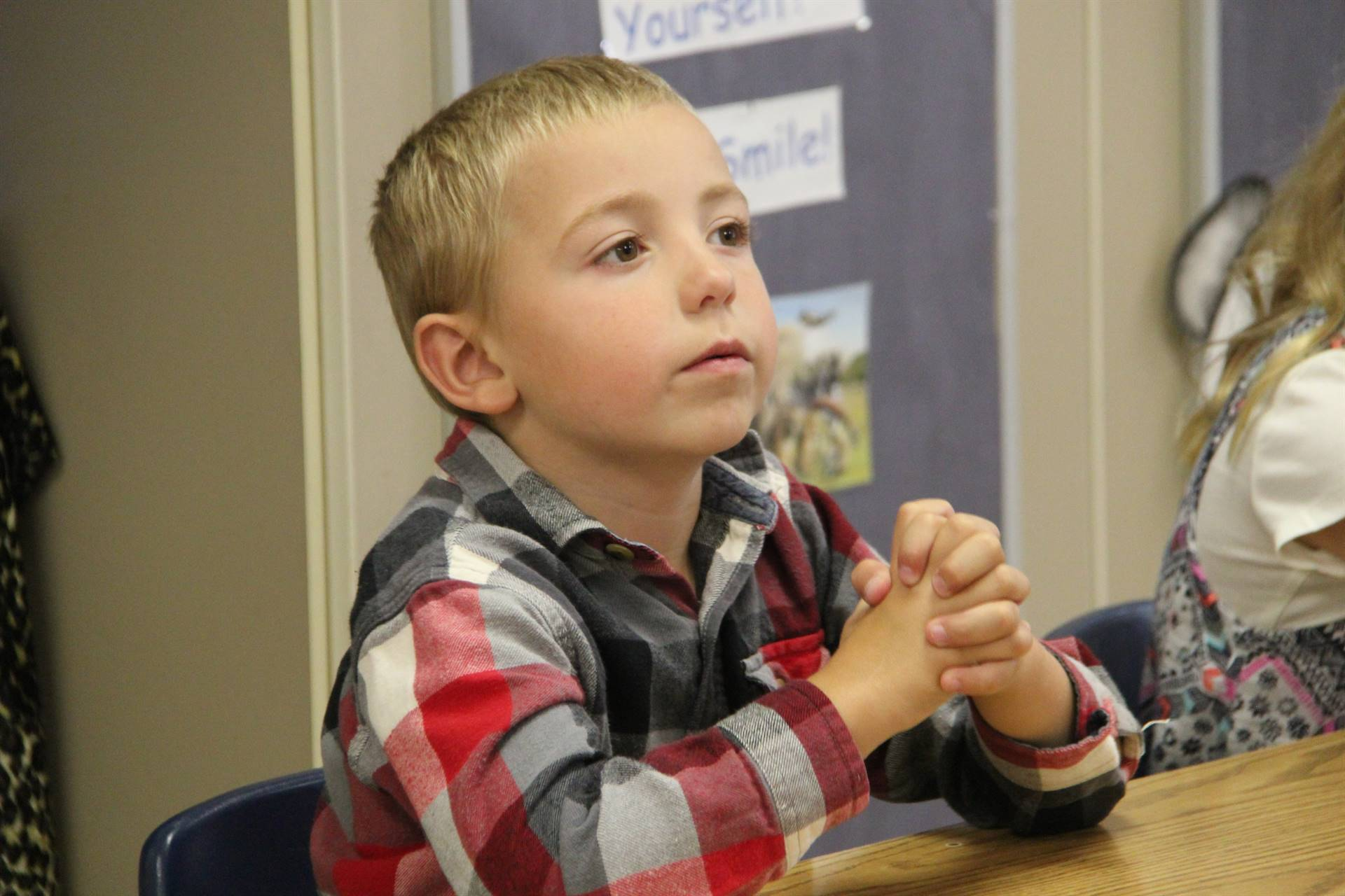 student listening intently at first day of school