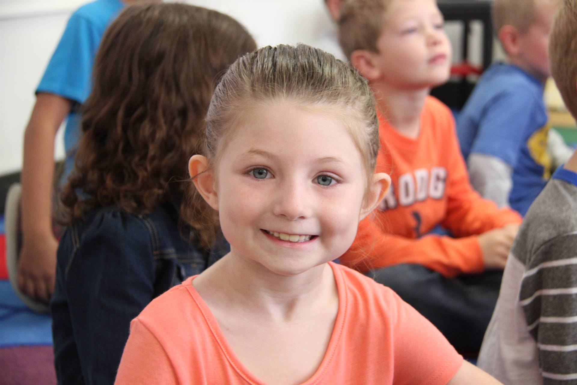 student smiles wide at first day of school at port dickinson elementary