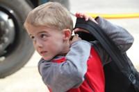 student walks toward port dickinson elementary school