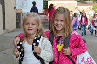 two girl students smile on first day of school