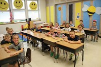 wide shot of classroom of students smiling at port dickinson elementary