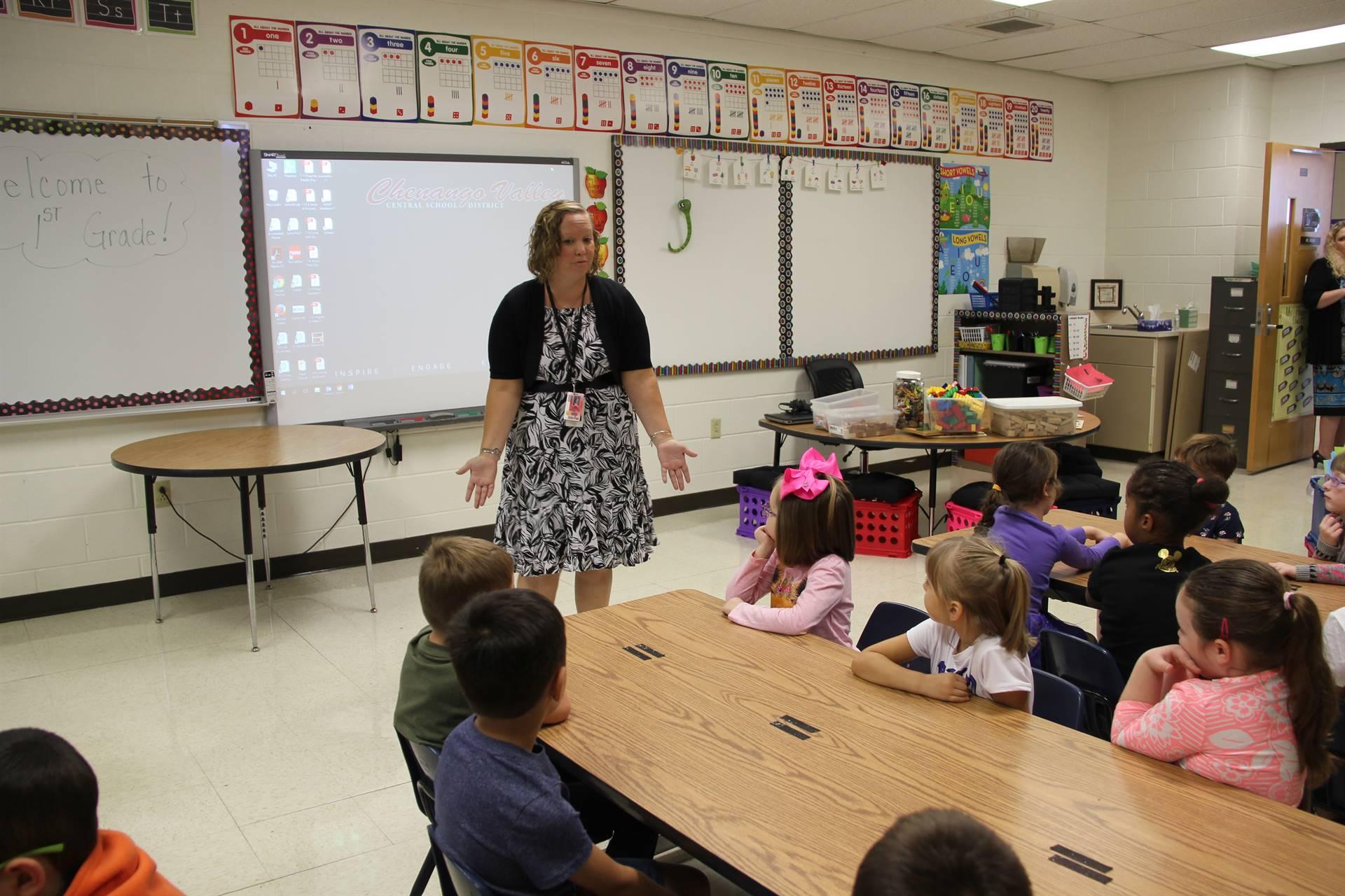 wide shot of first grade teacher teaching students