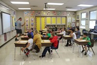 wide shot of teacher teaching a classroom of students