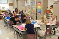 wide shots of students coloring on first day of school