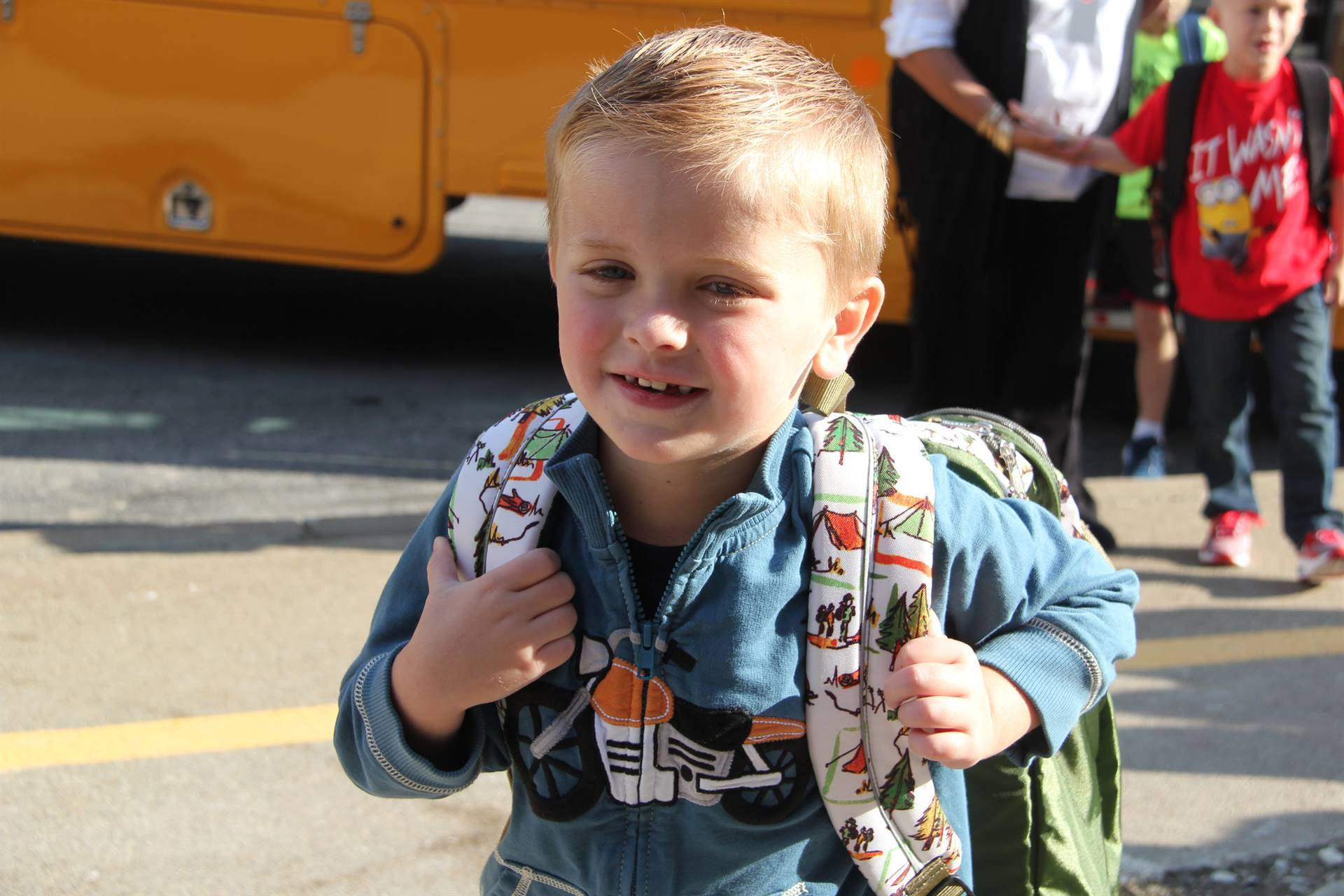 boy smiles ready for first day of school
