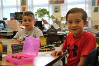 boys smile sitting in classroom on first day of school