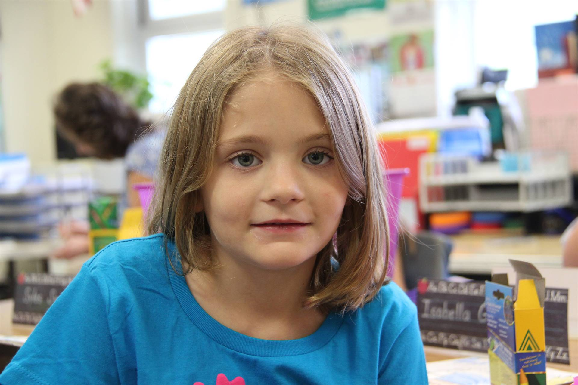 close shot of young elementary student smiling on first day