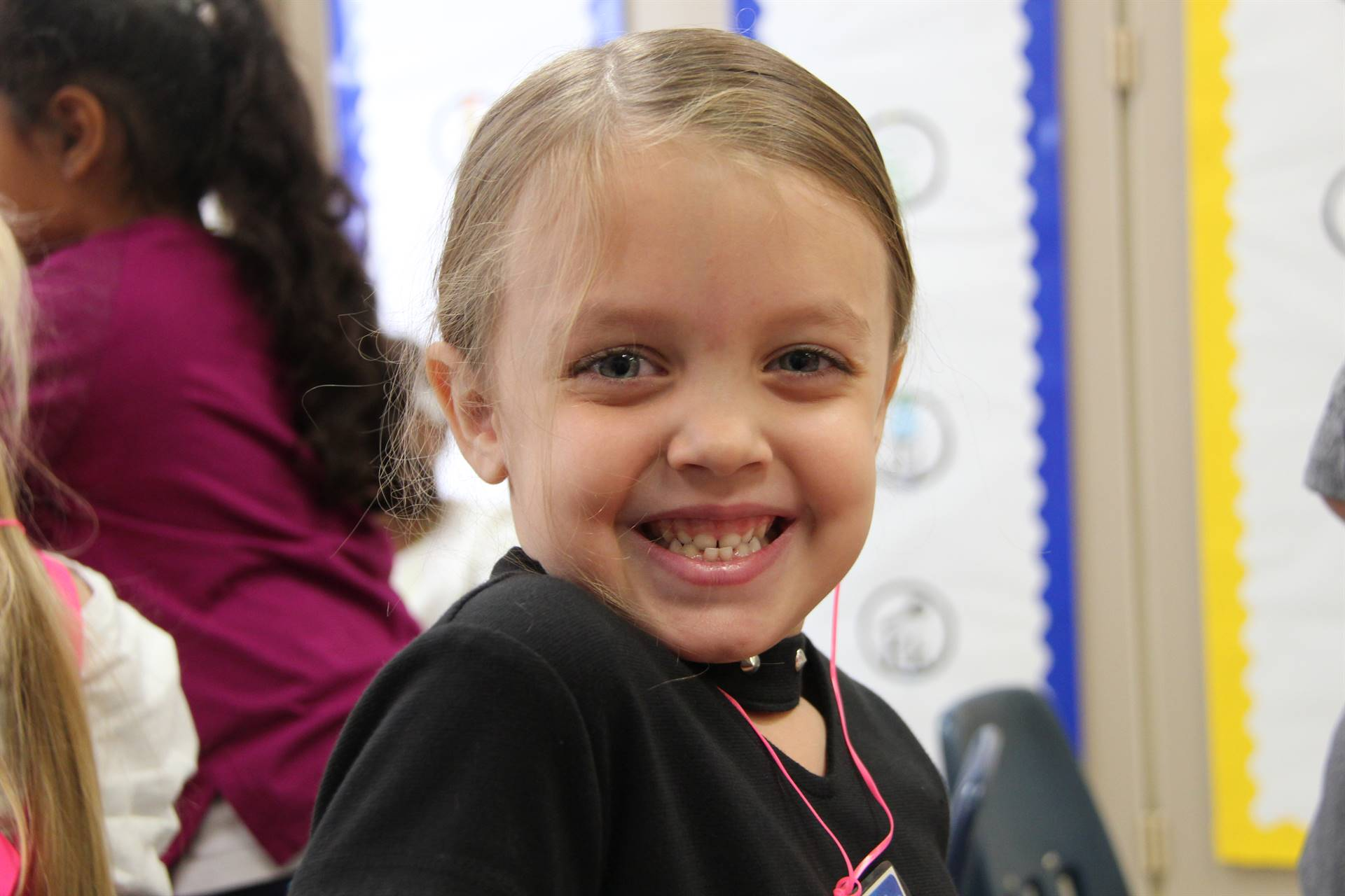 girl smiles wide on first day