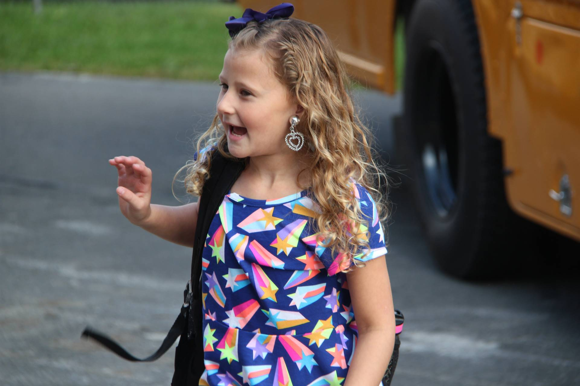 girl waves hi getting off bus on first day of elementary school at port dickinson elementary