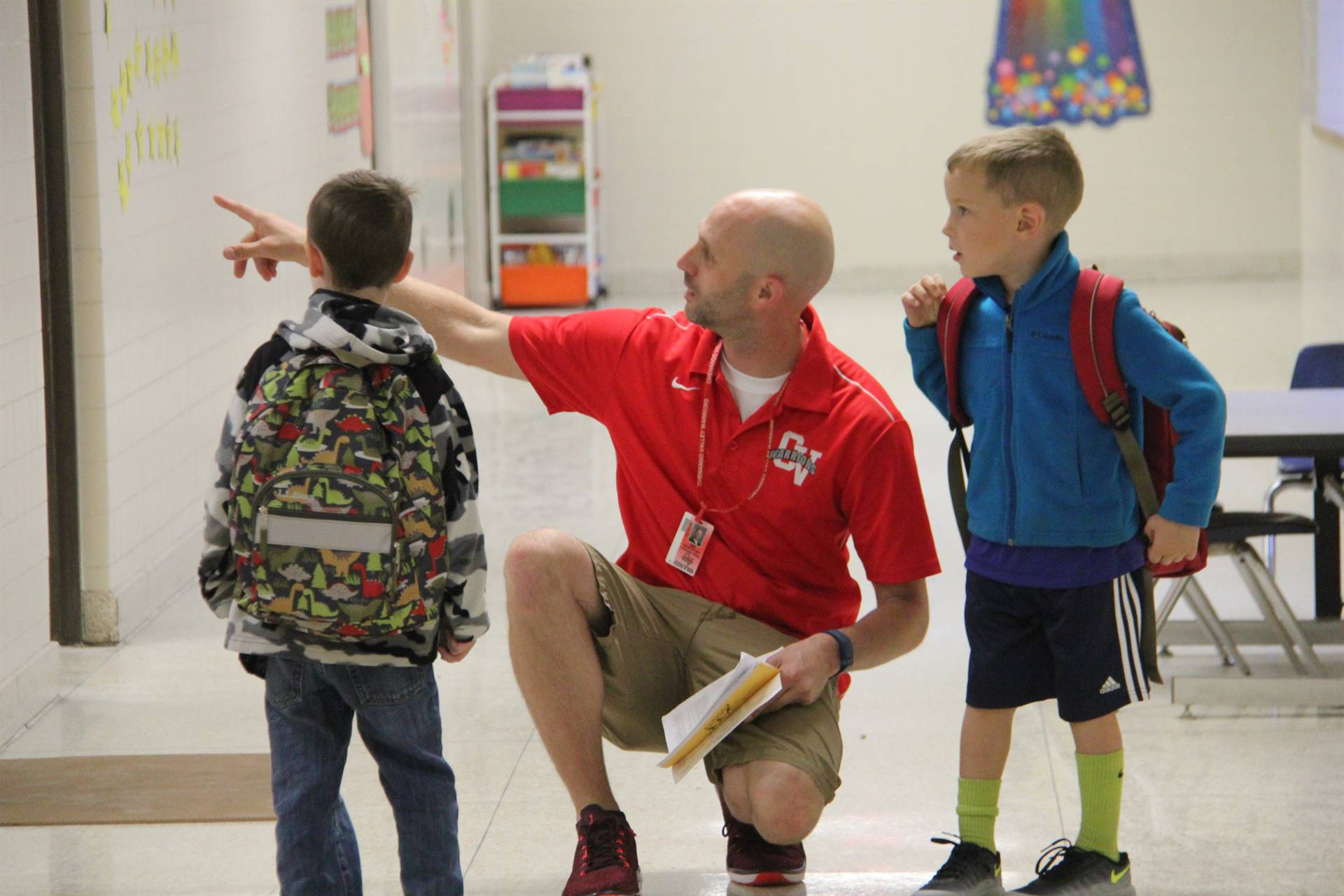 mister novotny helps students on first day of school