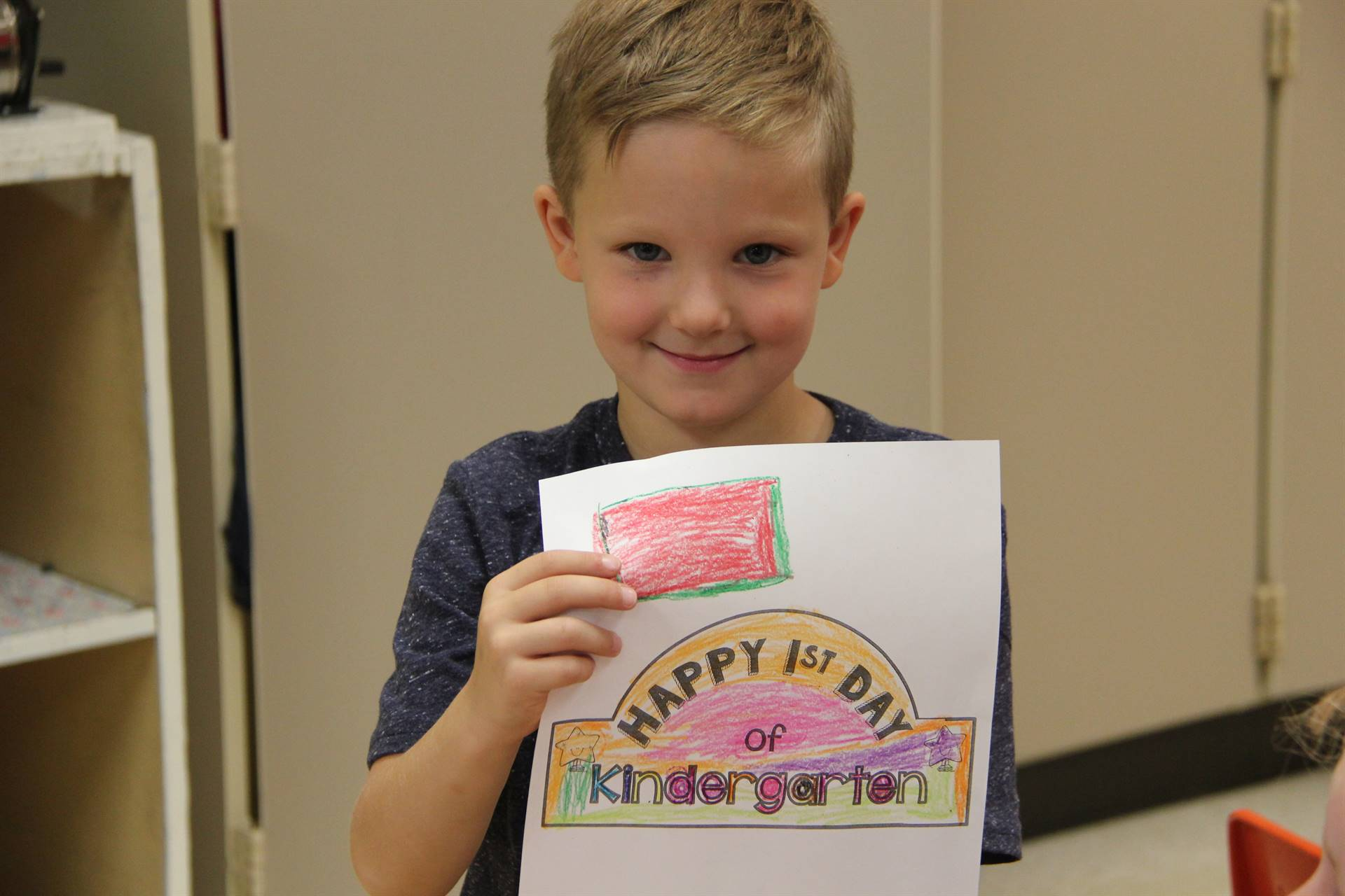port dickinson elementary student holding first day of kindergarten picture he colored