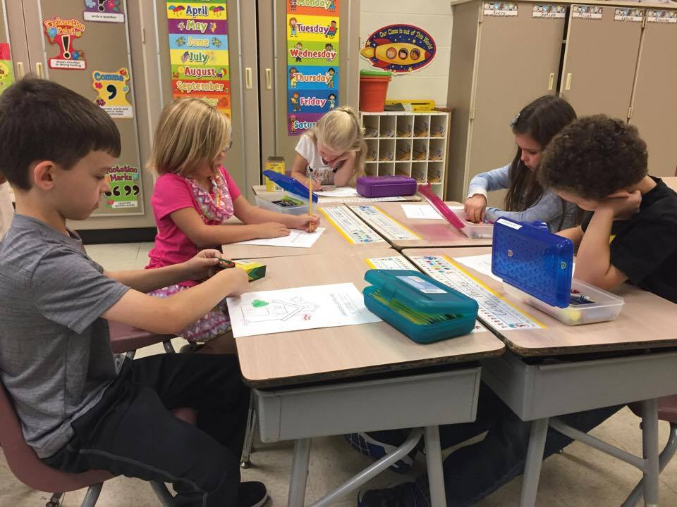 port dickinson elementary students coloring on first day of school