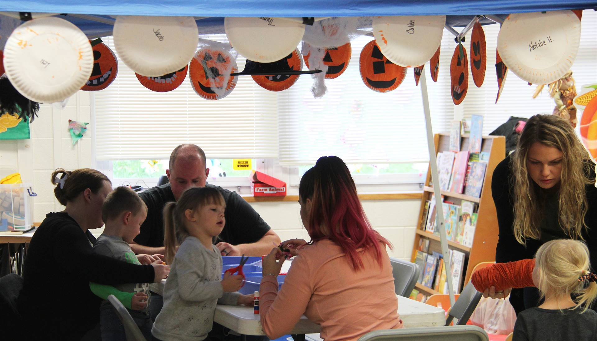 people working on scarecrow hat projects