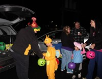 students getting candy at trunk or treat
