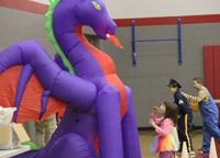 student looking at dragon