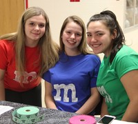 students wearing m and m shirts