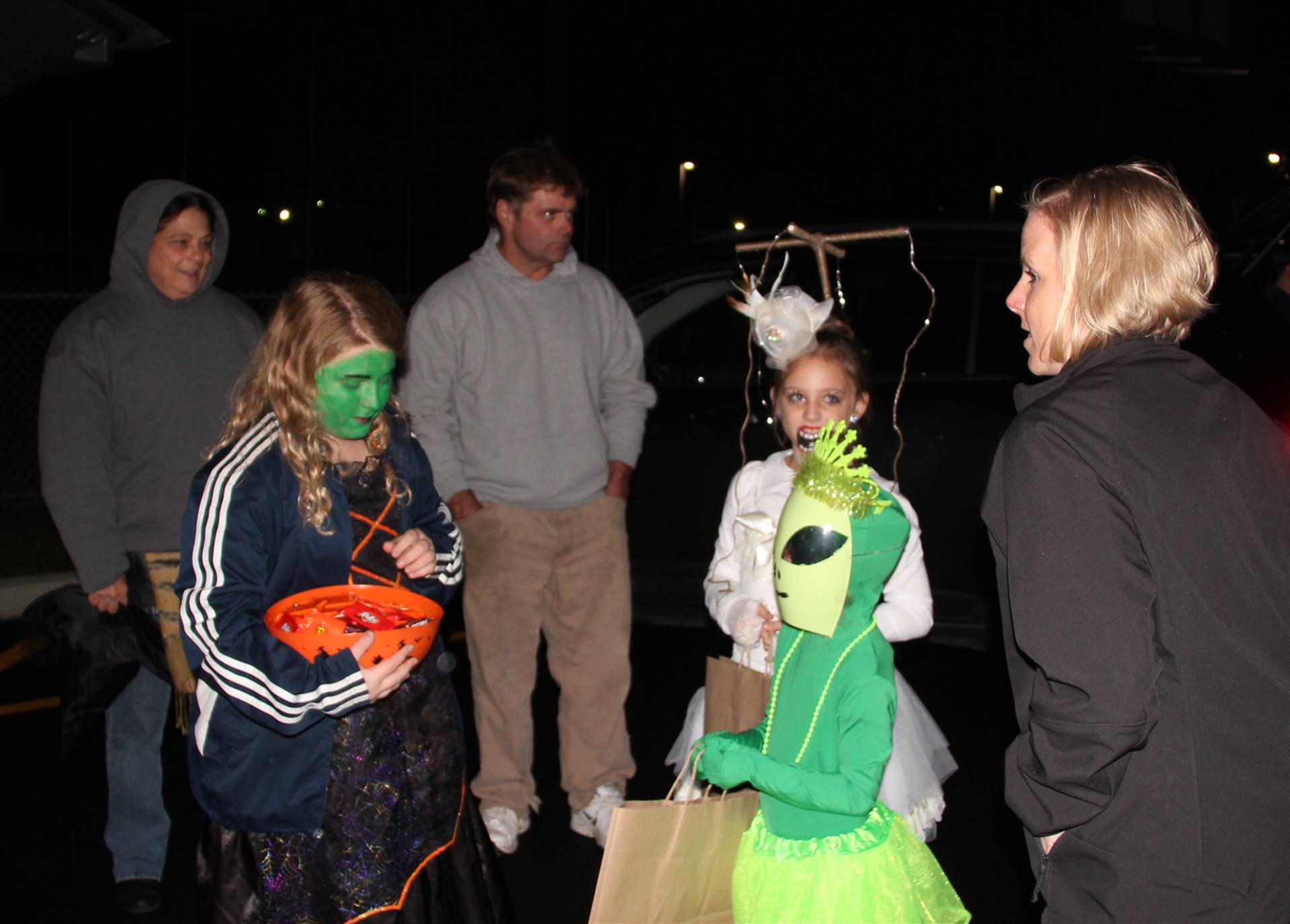students getting candy at trunk or treat event