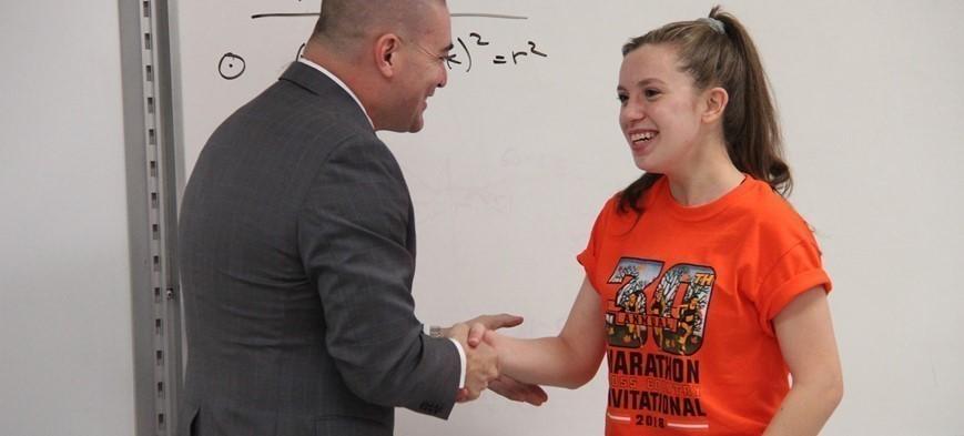 student shaking senators hand