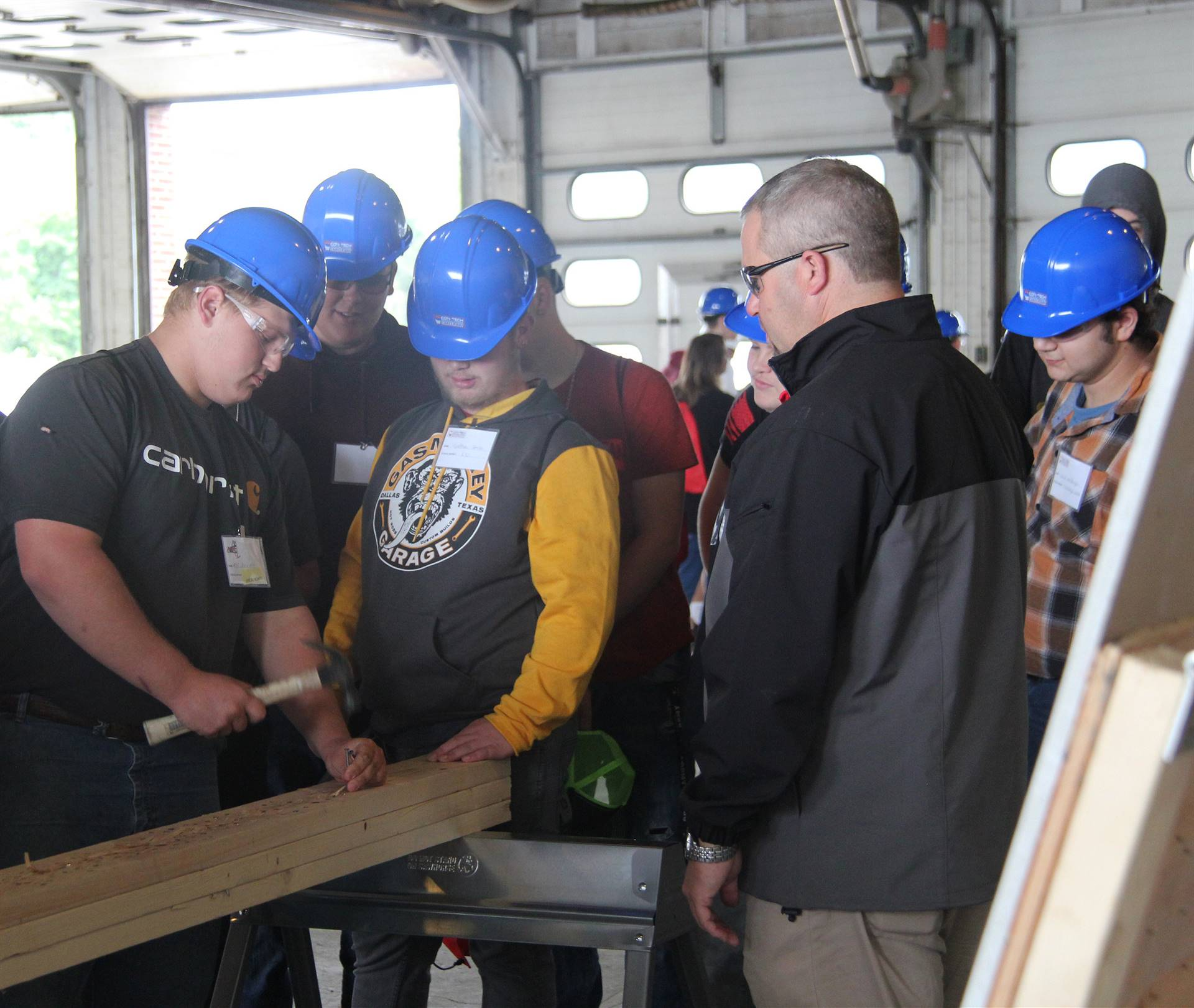 student working with hammer