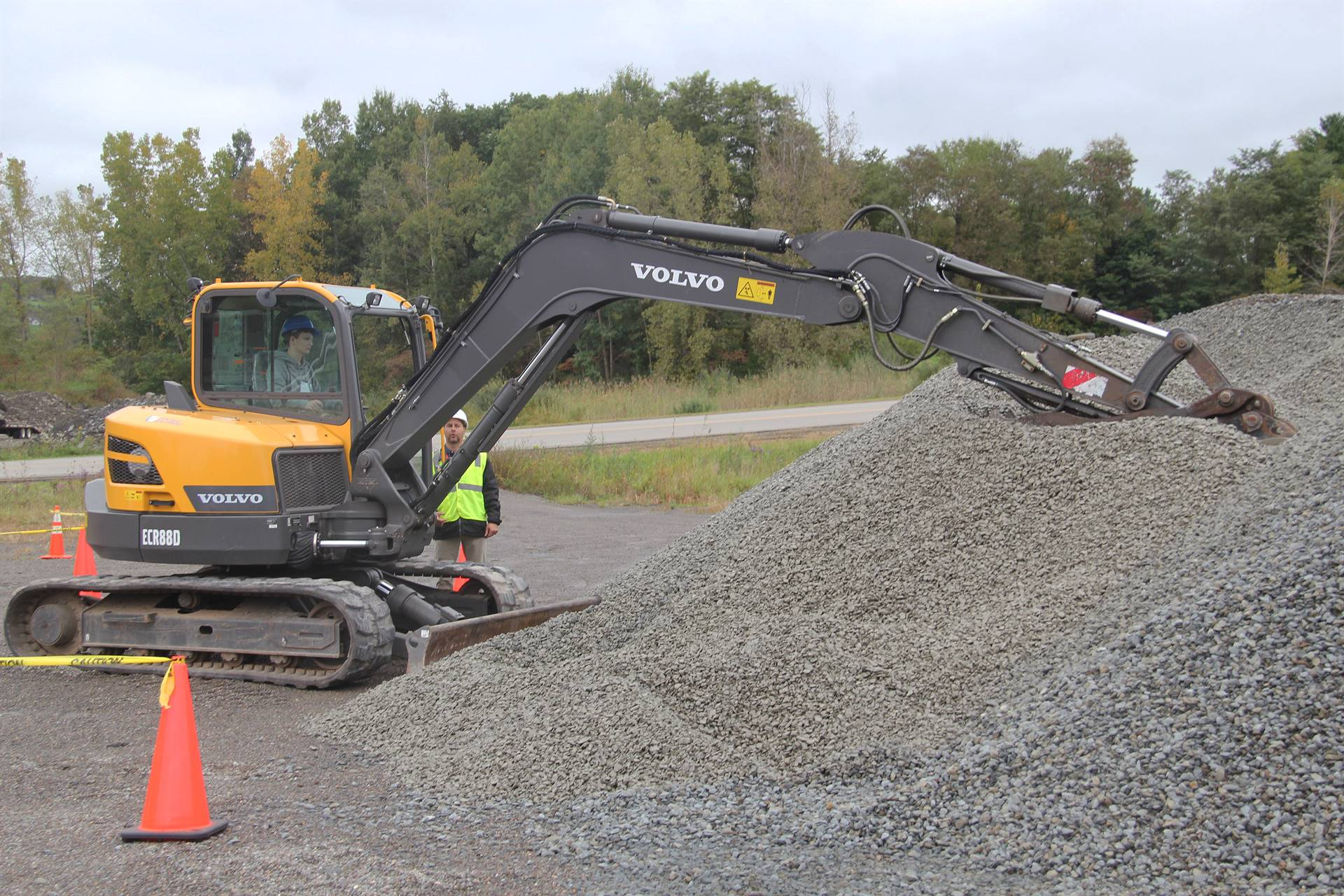 machinery digging into gravel