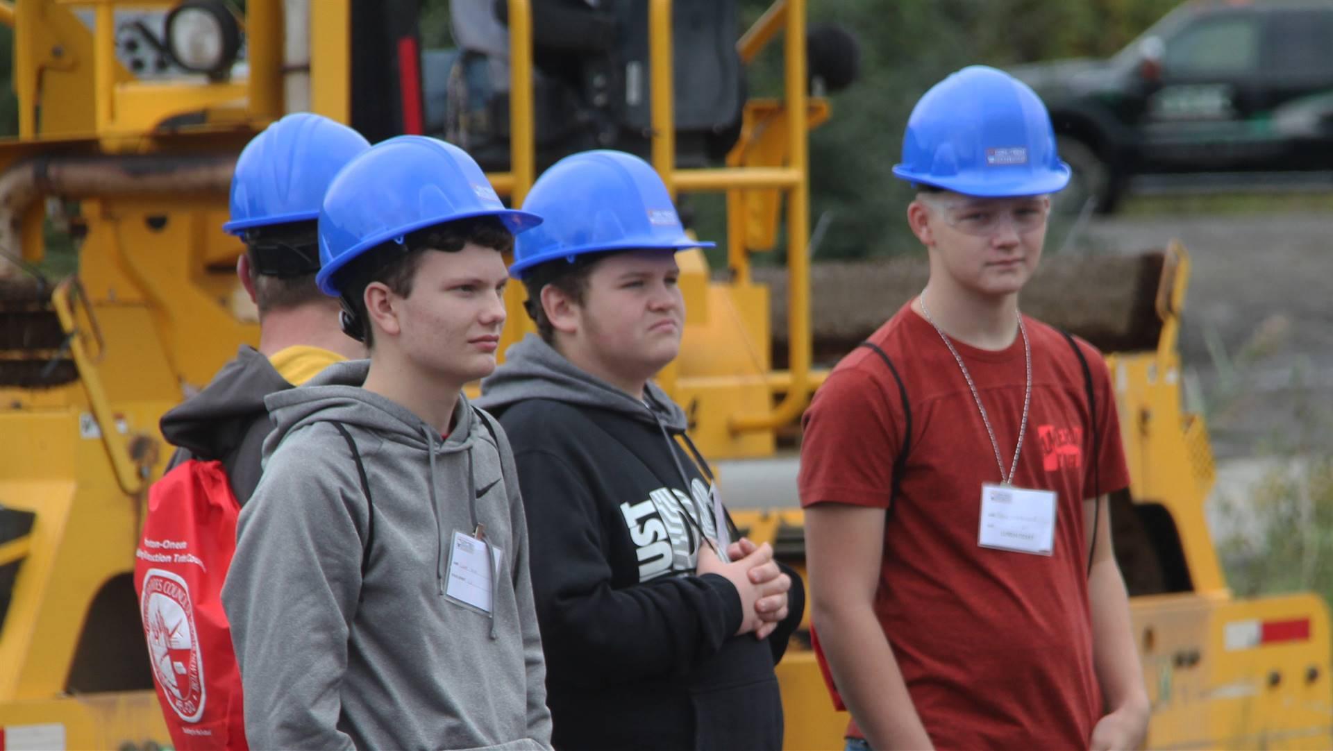 students watching machinery