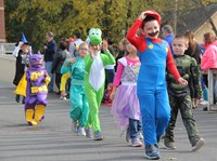 group of students walking in halloween costumes